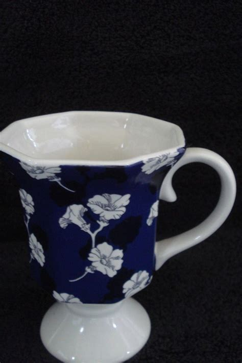 Most relevant best selling latest uploads. Spring Living White and Cobalt Blue Footed Floral Cup | Cobalt blue, White cups, Blue