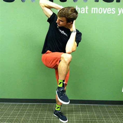 standing bicycle crunch   abdominal exercise
