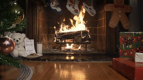 yule log fireplace gif find on giphy