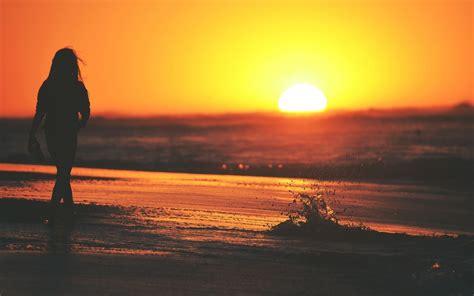 sunset women silhouette beach waves women outdoors