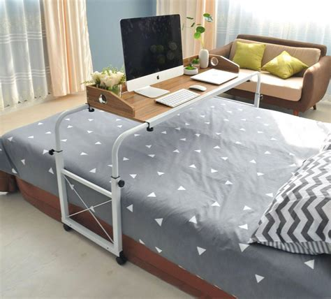 Desk For Bed by Bed Sliding Table Lets You Work And Eat In Bed