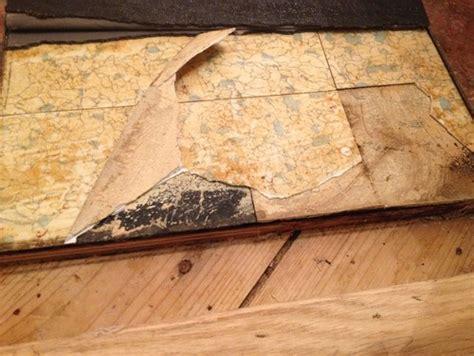 marmoleum click  possibly asbestos  vinyl tile