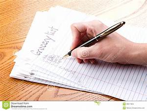 Writing grocery list stock photo. Image of black ...