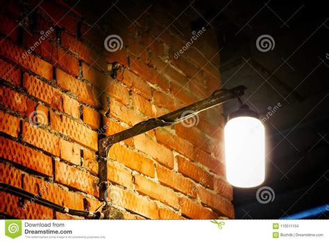 old red brick wall with street light image