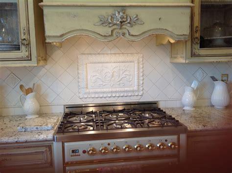 backsplash kitchen pressed floral tiles installed in kitchen backsplash