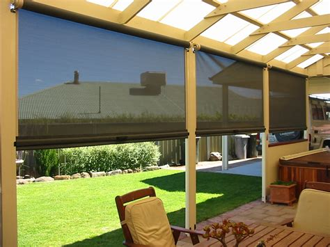 house with wrap around porch screen porch roll up blinds