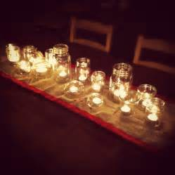 from the kitchen a simple centerpiece of tea lights in jam jars simple bites