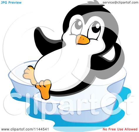 clipart iceberg of a penguin reclining on an iceberg