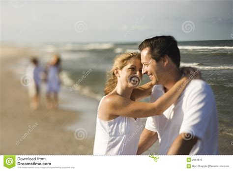 Mom and Dad hugging stock image. Image of mother, love