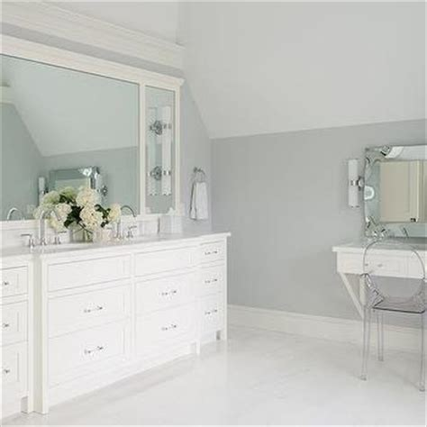white and gray bathroom with turquoise blue accents