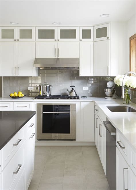 Glass Cupboards For Kitchens by Textured Glass In The Cabinet Doors Reflects The