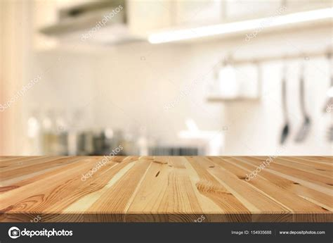 kitchen table background wood table top as kitchen island on blur kitchen