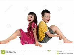 Happy Kids Sitting Back To Back Stock Photo