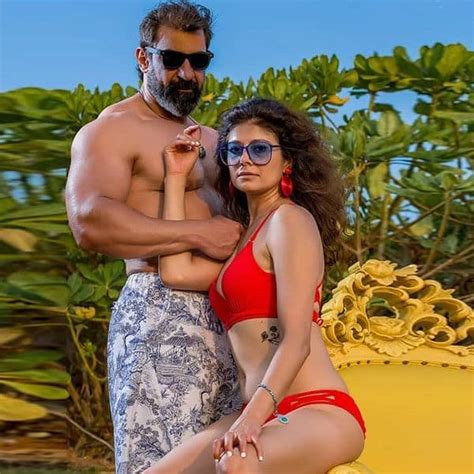 Pooja Batra Poses In A Red Bikini With A Shirtless Hubby