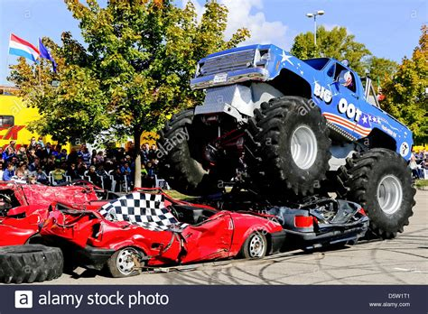 Monster Trucks Drive Over Old Cars At The Monster Truck