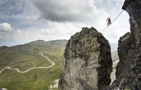 man ride mountain bike  slackline