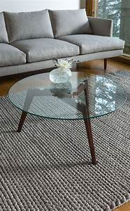 29 chic glass coffee tables that catch an eye digsdigs With glass coffee table with wooden legs