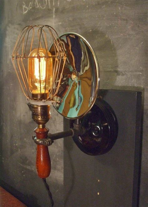 vintage industrial cage light with wall mount machine