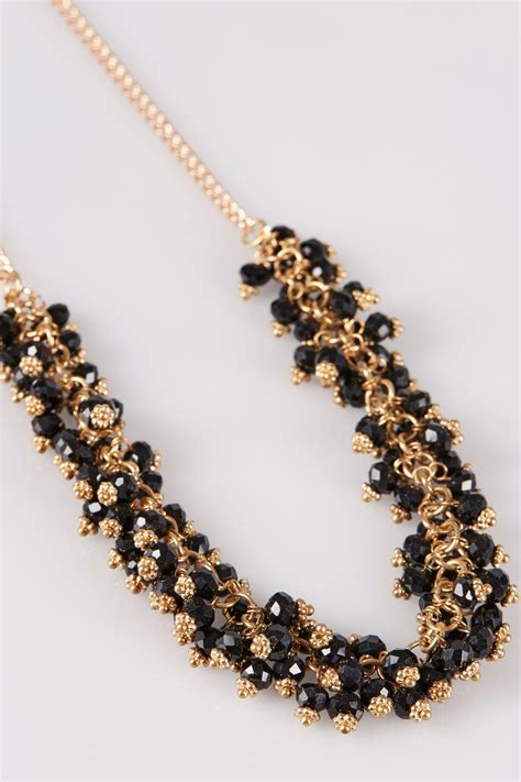 gold black beaded necklace earrings set