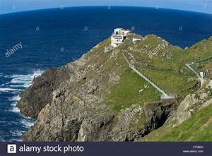 Steep cliffs with a lighthouse, Mizen Head, most south ...
