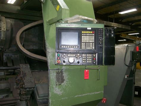 """Lic axis credit card customer care number. Okuma LC50-25C 4-Axis CNC Turning Center, Mdl LC50, S/N 0111.0153, (new 1990), 31.5"""" Swing, 49.2"""""""