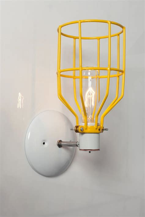 industrial wall light yellow industrial wall sconce yellow wire cage wall light