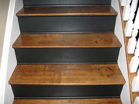 Quarter round matching risers.   Flooring, Trim & Hallways