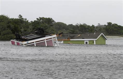 hermine thrashes carolina coasts  storm barrels north