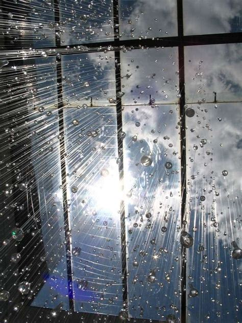 suspended glass drop installations rain  stacee