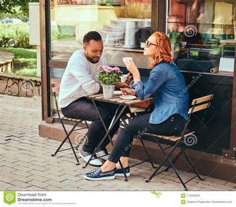 Coffee & espresso restaurants breakfast, brunch & lunch restaurants caterers. A Couple Dating Drinking Coffee, Sitting Near The Coffee Shop. Outdoors On A Date. Stock Photo ...