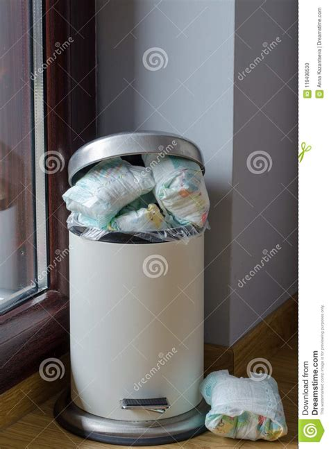 garbage  full   dirty diapers stock photo image