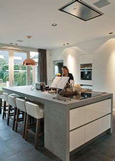 great kitchen cabinets white quartz countertops with waterfall edge emperador 1335