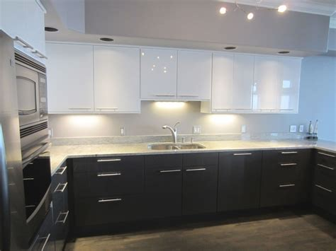 ikea furniture kitchen gray bottom white uppers hardware is installed