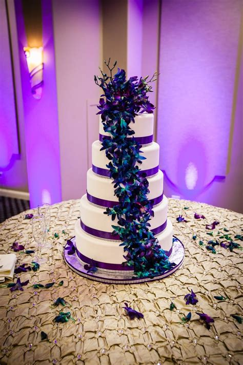 purple teal wedding cake with orchids purple teal and gold wedding wedding