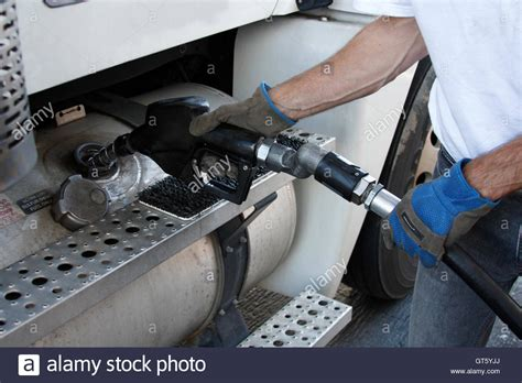 Man Filling Fuel Tank Of A Truck Stock Photo, Royalty Free