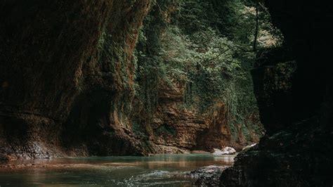 Download wallpaper 1366x768 cave, water, dark, stones ...