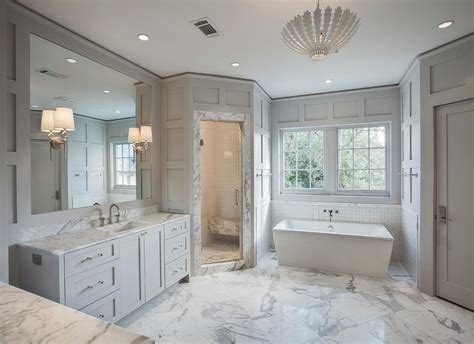 white and gray master bathroom with cast iron tub and