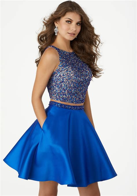 piece party dress featuring  fully beaded net top