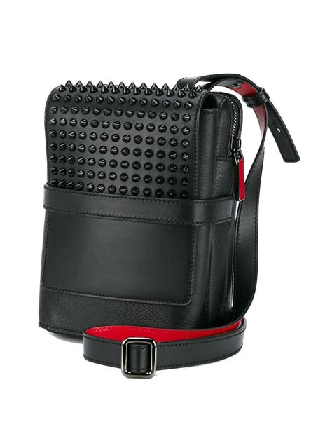 christian louboutin leather spiked reporter bag  black  men lyst
