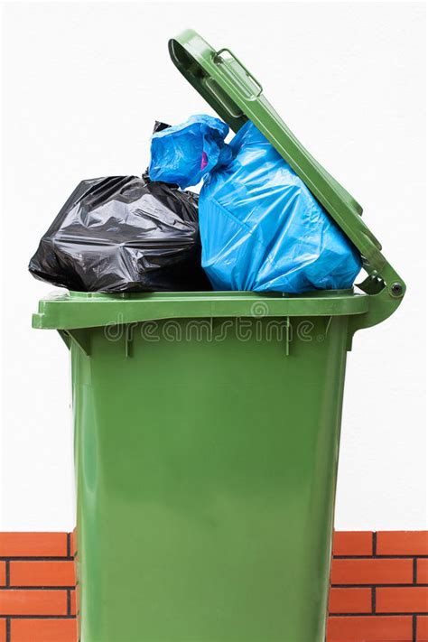 full green dustbin stock photo image  mess container