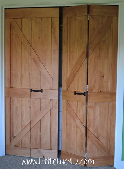 Rustic Dressing Room With Bifold To Barn Doors, And White