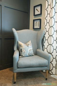 blue linen wingback chair board and batten wall