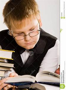 Smart Looking School Boy Reading A Book Royalty Free Stock ...