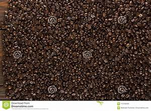 Roasted Coffee Beans On Wood Texture Stock Image - Image ...