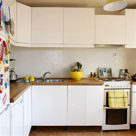 white kitchen  wooden worktops  inspired flat
