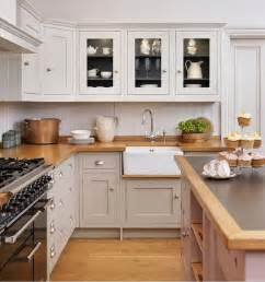 shaker style cabinets in a warm gray with darker gray interior butcher block counter top