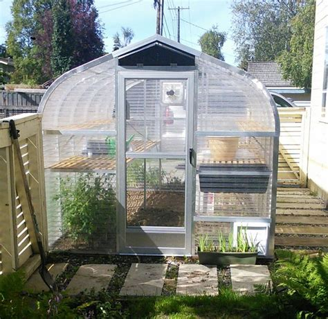 This cute little diy greenhouse looks like the kind of kitchen larder that the fairies would have. 8x15 Sunglo greenhouse. This customer used one side of her ...