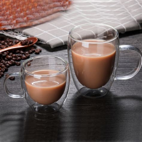 One side of the cup has christmas bells. 250ML Double Wall Insulated Glass Coffee Mugs Tea Cups for Espresso Latte