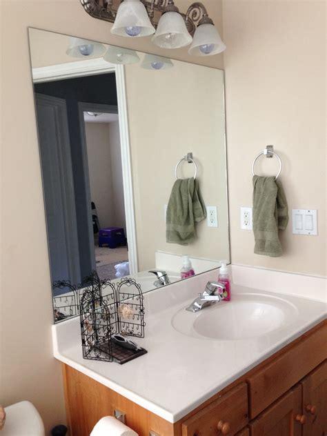 Stick On Frames For Bathroom Mirrors by Diy Stick On Mirror Frame Sawdust