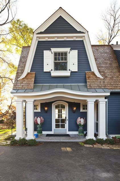 curb appeal with gambrel roof shutters and quaint colors exterior colonial